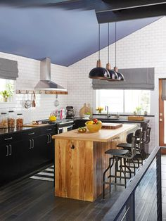 """The upcycled 6-foot-long white oak island was built using flooring torn out during the reno. To construct the top, Scott cut, sanded, planed, veneered, laminated, and sealed the boards. """""""