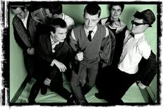 http://www.aroundforty.co.uk/madness.html The core of the band formed as The North London Invaders in 1976, and included Mike Barson (Monsieur Barso) on keyboards and vocals, Chris Foreman (Chrissy Boy) on guitar and Lee Thompson (Kix) on saxophone and vocals. They later recruited John Hasler on drums and Cathal Smyth (better known as Chas Smash) on bass guitar. Later in the year, they were joined by lead vocalist Dikron Tulane.