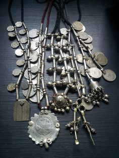 Old vintage coins, beads, and objects from Rajasthan, India. Silk Road Tribal.