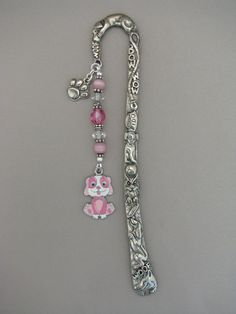 woof! <3  http://www.etsy.com/listing/78688642/beaded-bookmark-pewter-bookmark-hook