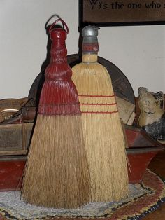 pair of primitive whisk brooms