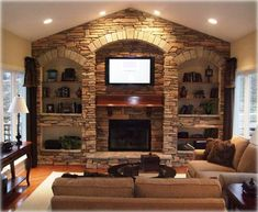 Stone wall with fireplace and built-ins. Something we could probably tackle ourselves and add lots of value