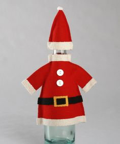 Give a spirited gift with a bottle of red or white in this playful Santa outfit. Constructed from natural materials and featuring a charming design, it adds festive flair to any holiday home.Hat: 3.5'' H x 2.25'' diameterCoat: 6.5'' H x 6'' diameterWool feltDry clean
