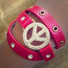 I just added this to my closet on Poshmark: ⚡️$15 SALE⚡️Red peace sign wrap bracelet . Price: $15 Size: OS