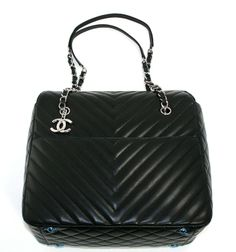 Chanel Black Lambskin Surpique Chevron Tote | From a collection of rare vintage handbags and purses at http://www.1stdibs.com/fashion/accessories/handbags-purses/