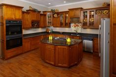 Shaker Cabernet Kitchen but def not with the dark counter top.