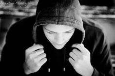 Kari Bruck Photography high school senior boy session pose idea. High school senior boy inspiration for posing for an urban setting. Senior Pictures for a guy in a black and white image.