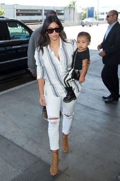 At LAX with North West in Los Angeles. Getty Images  - ELLE.com