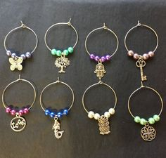 Items similar to Wine Glass Charms - set of 8 on Etsy Wine Glass Markers, Wine Glass Crafts, Wine Craft, Wine Painting, Wine Tags, Painted Wine Glasses, Wine Charms, Jewelry Crafts, Beaded Jewelry