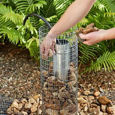 Add rock to the wire-mesh column.