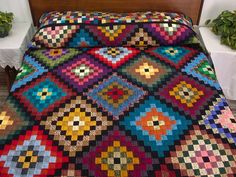 Made one like this for Mick 30 years ago  Many Trips Around the World amish quilts, shadow, finish squar, bright colors