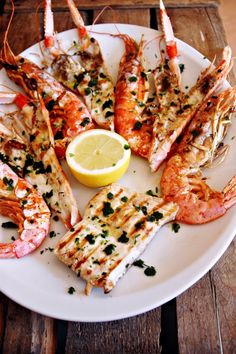 Seafood...Shrimp, fish and Cigalas done in the most amazing and simple Spanish way, a la plancha, then dressed simply with olive, oil, a little garlic, parsley and salt.  Perfect!