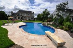 In this photo we see a pool patio made of wall nut paving stones in Shinnecock Hills, New York (11968). This backyard is truly breath taking; there are so many great features that make up this backyard al based around this patio. The pattern that these pavers are placed in off the back give this backyard a clean cut look. The free form in ground swimming pool its self is a great piece to entertain family and friends but it also has a diving rock and water fall spilling into it. 631-670-6868