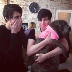 Dan looks offended he doesn't get to hold the dog