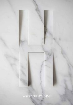 SKHY Apartments - sign in marble.