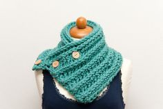 Scarflette (neckwarmer, cowl, scarf) from chunky blue/glacier acrylic yarn in a ribbed pattern with wooden buttons