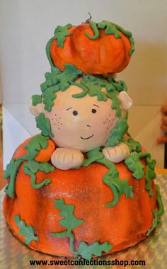 My Little Pumpkin Baby Shower Cake.  This is one of our favorite baby shower cakes.  It is a little one coming out of a pumpkin Patch.