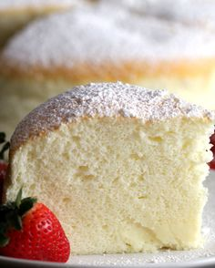 Pour powdered sugar, cut it to the size of your choice, serve on the plate, add strawberries and finish
