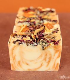 Juicy Orange & Sweet Rose Cold Process - Soap Queen I'm a huge fan of fancy swirled tops, but for this recipe I decided to switch things up. This orange-scented soap is piled high with orange peels and rose petals, … Soap Making Recipes, Homemade Soap Recipes, Homemade Paint, Diy Cosmetic, Diy Rose, Savon Soap, Rose Soap, Diy Spa, Soap Packaging