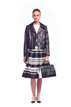 Feminine skirt toughened up with a black leather jacket | Kate Spade New York SS15 Fashion Week