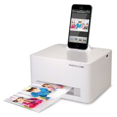 The iPhone 5/6 Photo Printer - In less than 59 seconds and without ink cartridges, it prints crystal-clear 300 dpi resolution pictures with vibrant colors, thanks to patented paper embedded with yellow, magenta, and cyan dye crystals. - #HammacherHolidays