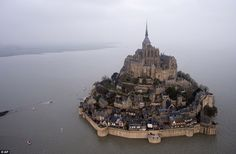 Tens of thousands of people are visiting the Atlantic coastline in France, including Mont Saint-Michel, for the 'supertide'
