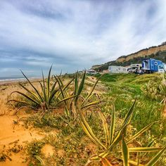 Beachfront location with sandy track and many little bars and restaurants. All that some 15 kilometers from Lisbon  #digitalnomad #travel #beachfront #overland #caravan #family #gurucamper #nomads #portugal #lisbon #surfing #cactus