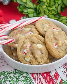 White Chocolate Candy Cane Cookies   A chewy, buttery cookie filled with white chocolate chips and crushed candy canes thatskinnychickcanbake.com @lizzydo