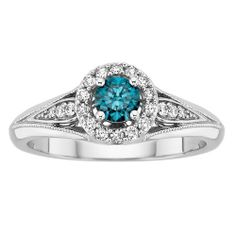 My Ring! He proposed on 12/12/12! Blue diamond and white gold. LOVE