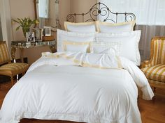 Monterey - Luxury Bedding - Italian Bed Linens - Schweitzer Linen   As fresh as if borne on a spring breeze, winsome daisies, delicately #handembroidered in Pink or Yellow, are linked by a latticework of greenery. This gossamery design decorates a luxurious 600 thread count, 100% Egyptian #cotton #percale from Italy. Imported, complete with flanged edges, mitered corners and delicate #hemstitching. Truly museum quality.