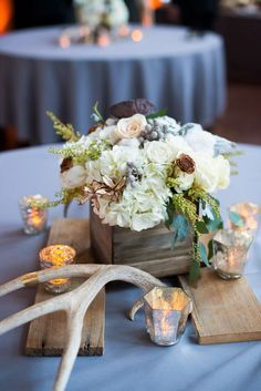 Love the square box from pallet wood to hold arrangement