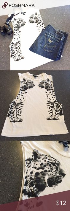 Roar!! Leopard graphic tank size small Forever 21 leopard print tank. Super soft. Wide arm openings- would be cute over a bralette.  Jeans are also listed in my closet. Forever 21 Tops Muscle Tees