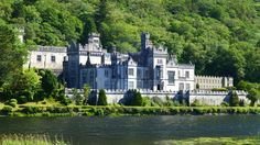 """""""Kylemore Abbey (Irish: Mainistir na Coille Móire) is a Benedictine monastery founded in 1920 on the grounds of Kylemore Castle, in Connemara, County Galway, Ireland. The abbey was founded for Benedictine Nuns who fled Belgium in World War I. Kylemore Castle was built as a private home for the family of Mitchell Henry, a wealthy doctor from London whose family was involved in textile manufacturing in Manchester, England."""""""