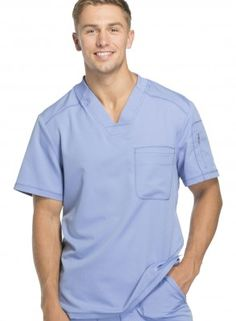A Men& V-neck top features a knit collar with bungee loop, front yokes, a welt chest pocket, zip-closure sleeve pocket, tonal logo heat transfer and back panels. Center back length: Sizes: XS - Color: Ciel Blue (CIE) Brand: Dickies Scrubs Uniform, Men In Uniform, Healthcare Uniforms, Hot Doctor, Dickies Workwear, Uniform Design, Glamour, Cute Guys, V Neck Tops