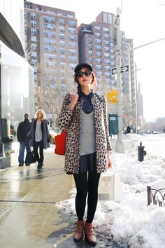 Leather dress, leather skirt, leather shirt, cheetah trench coat, brown booties, gray sweater, black tight, leather baseball cap, red purse