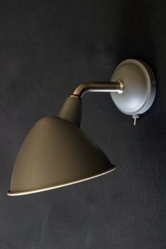 This beautifully refined wall light with its stunning lines and charcoal grey colour would add sophistication to any space in need of soft focused Bedside Wall Lights, Bathroom Wall Lights, Wall Lamps, Lighting Uk, Bedroom Lighting, Kitchen Lighting, Lighting Ideas, Rocket St George, Bookcase Wall
