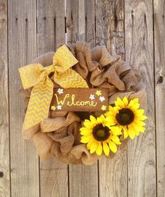 This wreath is hand crafted on a 12 inch wreath form and with the burlap loops stands to be approximately 15.5 inches in diameter. The welcome sign