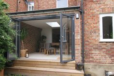 """Love the """"indoor to outdoor"""" doors Bifold door entry to new dining room - contemporary - dining room - london - DTA Architecture Patio Steps, Brick Steps, Garden Steps, Door Steps, Bifold Doors Onto Patio, Exterior Front Doors, Kitchen Patio Doors, Bungalow, House Extension Design"""