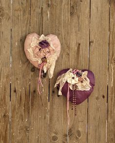 Set of two silk hearts in purple and old pink color. They are adorned with handmade by me fabric flowers, lace, pearls and costume jewelries. These hearts are perfect for a unique wedding decoration or wedding gift as well. They can also be used throughout the year decoration; they will transmit romance and style to your home. They are perfect dor shabby chic and boho lovers.