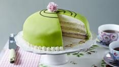 Prinsesstårta - This Swedish layer cake is great fun - bright green and full of custard, jam, marzipan, and a mound of whipped cream!