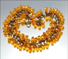 Gorgeous early Miriam Haskell necklace with golden amber faceted glass beads topped with gold gilt filigree caps.