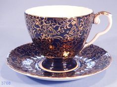 Black and rose gold teacup and saucer