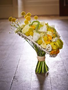 Assymetric yellow wedding bouquet created using the best spring flowers.