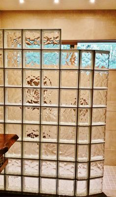 This glass block curved shower wall was added in a Japanese themed to give the feel of a shoji screen - but also to provide a solid and sturdy wall.   Innovate Building Solutions