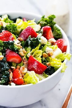 Crunchy, fresh kale salad tossed with juicy strawberries, walnuts, blue cheese crumbles and homemade creamy poppyseed dressing. | Creme de la Crumb