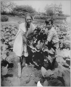 School children holding one of the large heads of cabbage raised in the war garden of Public School 88, Borough of Queens, New York City. The garden covers a tract of 1< acres and yielded over $500 worth of produce, ca. 1918.