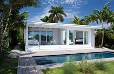 The house has a tropical pool area and it share a tennis court with next-door-neighbor. Beach Bungalow Exterior, Small Beach Houses, Modern Pools, Beach Cottage Style, Beach Bungalows, Beach Shack, Florida Home, Florida Style, Pool Houses