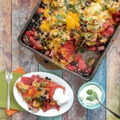 Cheesy Ham and Black Bean #Nachos with freshly roasted Jalapeno Chilies.