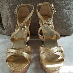 """Banana Republic Gold Wedge Sandal This 4"""" wedge sandal is gold with a snake embossed texture.   The wedge is cork. Very versatile and can easily be worn as a neutral. Banana Republic Shoes Wedges"""