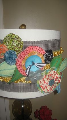 I need to buy a plain lampshade to jazz up. Definitely not to this extent, but I need a blank canvas.